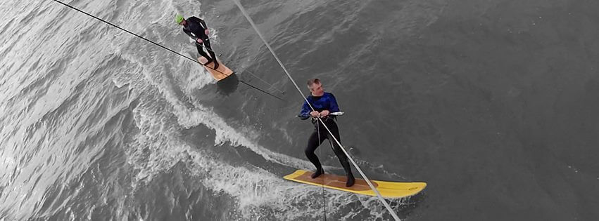Russell Farington towing-in a buddy on a Kite Alaia