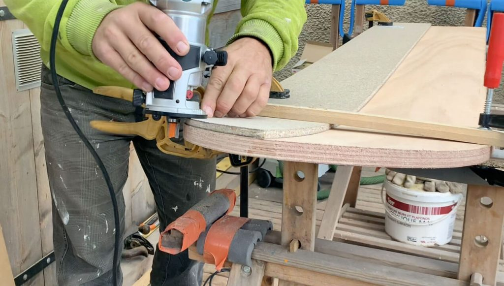 Removing the excess wood with a small scale router & copy bit