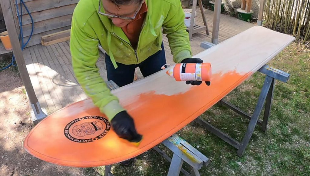 Applying the colour directly to the raw wooden Kite Alaia deck